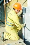 Facade Plasterer at exterior insulation work Stock Photo