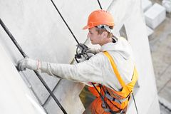Facade Plasterer worker at work Royalty Free Stock Photo