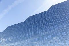Facade of rabobank head office in dutch town of utrecht. Utrecht, netherlands, 15 march 2017: glass facade of rabobank head office in dutch town reflects clouds Stock Images