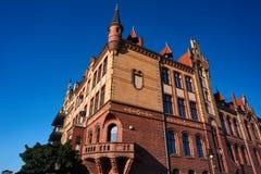The facade of red brick building Stock Photos