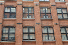Facade of red brick building Stock Photography