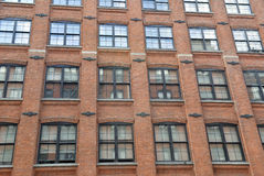 Facade of Red Brick Building Stock Image