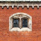 Facade. Red brick facade with double stone window stock photos