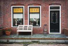 Facade of red brick home Stock Photography