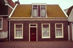 Facade of red brick home Stock Photo