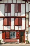 Facade with red windows Royalty Free Stock Image