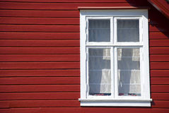 Facade of red wooden scandinavian house Royalty Free Stock Images