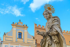 Facade of Renaissance houses and Holy Mary Statue in Telc Stock Photo