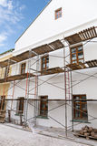 Facade of renovation building with scaffolding Stock Image