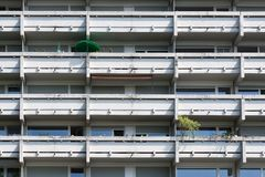 Monotonous reinforced concrete balconies. Facade of a residential building with balcony. Monotonous reinforced concrete balconies stock image