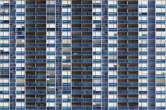 Facade of a residential building. Seamless texture of a residential building Stock Photos