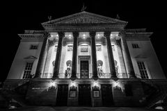Facade of the restored Staatsoper building. BERLIN - OCTOBER 08, 2017: Facade of the restored Staatsoper building in the evening illumination. Black and white Stock Photo