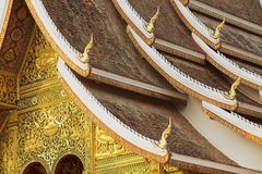 Facade and roof decoration of the Haw Pha Bang Buddhist temple at the Royal Palace Museum in Luang Prabang, Laos. royalty free stock photo