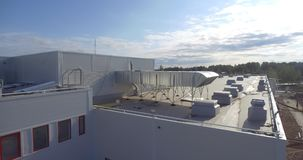 The facade and roof of the new factory. Aerial footage stock video footage