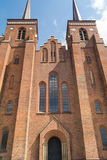 Facade of Roskilde Cathedral. The facade of Roskilde Cathedral in Denmark with two towers. Roskilde Cathedral Domkirke is the burial site for the Royal Family Royalty Free Stock Image