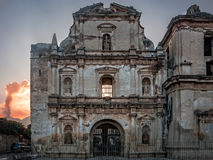 Facade of a ruined building in Antigua, with El Fuego volcano in the background. ANTIGUA, Guatemala - March 2, 2016: Facade of a ruined Church in Antigua royalty free stock image