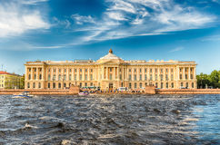 Facade of the Russian Academy of Arts, St. Petersburg, Russia. Facade of the Russian Academy of Arts on the Neva River, iconic landmark of St. Petersburg, Russia Stock Images