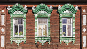 Facade Russian house with carved architraves Stock Photos