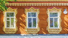 Facade Russian house with carved architraves Stock Images