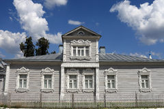 Facade of russian wooden house Stock Images