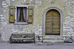 Facade rustic. House built with stones and window curtains typical royalty free stock photography