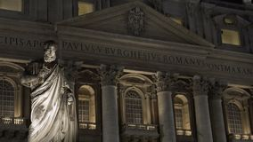 Facade of Saint Peter's Basilica at night, antique monument in front of building. Stock footage stock video footage