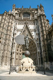 Facade of Seville cathedral. Facade of landmark catholic cathedral of Saint Mary of the See, and famous vane named Giraldillo, public gothic monument year 1507 stock photo