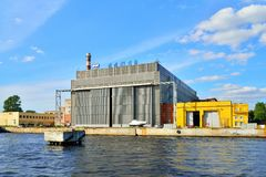 The facade of the ship plant JSC Almaz on the Neva river under b. ST.PETERSBURG, RUSSIA - AUGUST 09, 2017:  The facade of the ship plant JSC Almaz on the Neva Stock Image