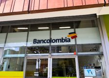 Facade and sign of an office of Bancolombia, a Colombian bank in Medellin royalty free stock photos