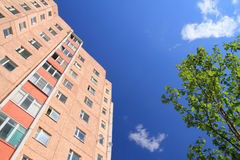 Facade of skyscraper with apartments with blue sky Royalty Free Stock Photo