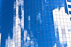 Facade of Skyscraper with reflection of sky Royalty Free Stock Photo