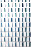 Facade of skyscraper with windows structured in rows with differ Royalty Free Stock Photos