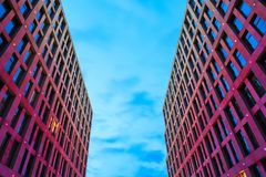 Facade of skyscrapers with beautiful yellow and pink illumination against the background of blue sky at night, Dnepr city stock photos