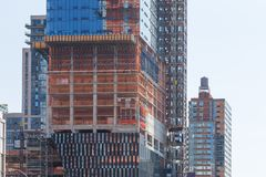 Facade of skyscrapers during construction, New York. Street perspective New Yorker buildings. Facade of skyscrapers during construction, New York, USA Stock Photography