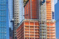 Facade of skyscrapers during construction, New York. Street perspective New Yorker buildings. Facade of skyscrapers during construction, New York, USA Royalty Free Stock Images
