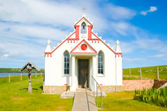 Facade of a small rural church in the countryside - The italian chapel, UK. Small rural church in the countryside - The italian chapel, Orkney, Scotland, UK Royalty Free Stock Photography