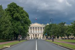 Facade of the Smolny Institute the official residence of the go. Vernor of St.Peterburg now with a Lenin statue in the foreground. Russia stock photography