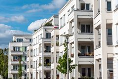 The facade of some white modern apartment buildings. Seen in Berlin, Germany stock images