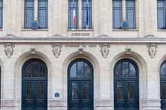 Facade of Sorbonne University with France and European Union flags, Paris, France. Facade of Sorbonne University with France and European Union flags. Name is stock photos