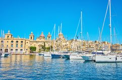 St Lawrence church on the coast of Birgu, Malta. The facade of St Lawrence San Lawrenz Church with huge dome and scenic bell towers on the coast of Birgu with Stock Image