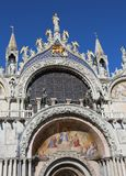 Facade of St. Mark`s Basilica in Venice with the splendid golden. Facade of St. Mark`s Basilica in Venice, Italy with the splendid golden winged lion Royalty Free Stock Photo