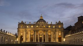 Facade of St. Peter`s Basilica at night, Vatican city. Facade of St. Peter`s Basilica at dusk, Vatican city Royalty Free Stock Photo