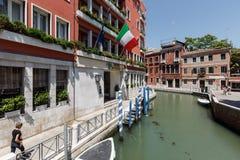 Facade of 4 stars Hotel Papadopoli in Venice, Italy, Europe. Venice, Italy - June, 21, 2013: view of Facade of 4 stars Hotel Papadopoli, people walk along the Stock Image
