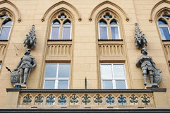 Facade with statues of knights Stock Image