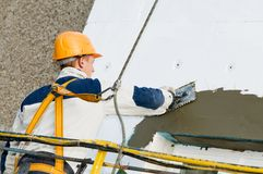 Facade stopping and surfacer works Royalty Free Stock Photo