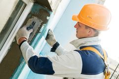 Facade stopping and surfacer works. Facade thermal insulation works with stopping and surfacer Royalty Free Stock Images