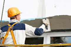Facade stopping and surfacer works. Facade thermal insulation works with stopping and surfacer Stock Images