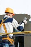 Facade stopping and surfacer works. Facade thermal insulation works with stopping and surfacer Stock Photos