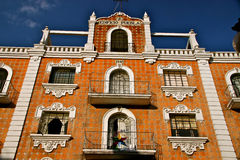 Facade with talavera tiles, Puebla, Mexico. Puebla, World Heritage Site since 1987, is famous for its Talavera pottery. Talavera tiles were used extensively in Royalty Free Stock Image