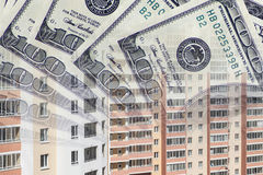 The facade of a tall building in the background of the Bank bills . Royalty Free Stock Image